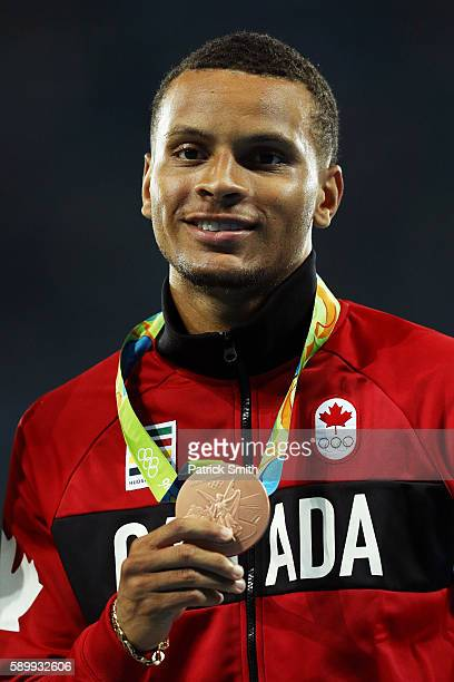 Bronze medalist Andre de Grasse of Canada poses on the podium during the medal ceremony for the Men's 100 metres on Day 10 of the Rio 2016 Olympic...