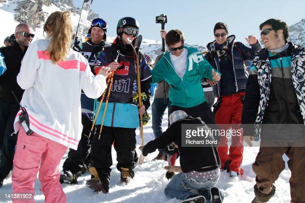 Bronze medalist Andreas Hatveit from Norway and Silver medalist Tom Wallisch are surrounded by fans after the Men Ski Slopestyle Final of the Winter...