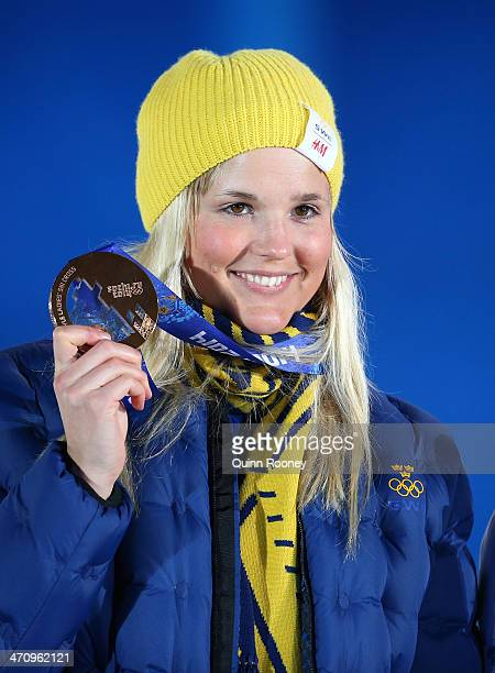 Bronze medalist Anna Holmlund of Sweden celebrates during the medal ceremony for the Women's Ski Cross on day fourteen of the Sochi 2014 Winter...