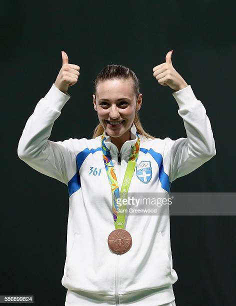 Bronze Medalist Anna Korakaki of Greece smiles during the medal ceremony for the Women's 10m Air Pistol event during the shooting competition on Day...