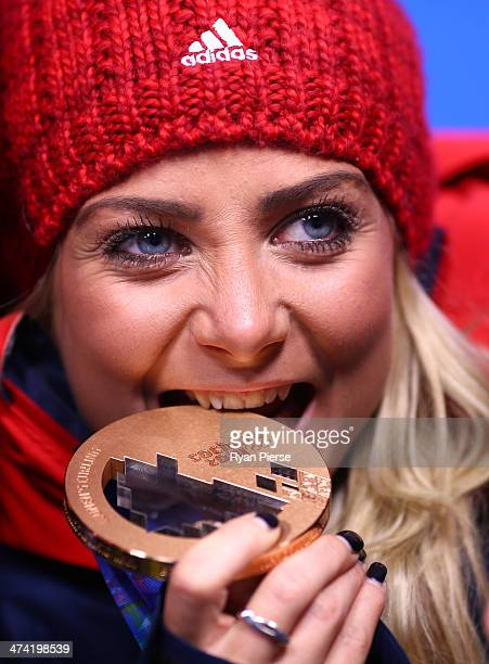 Bronze medalist Anna Sloan of Great Britain celebrates during the medal ceremony for Women's Curling on Day 15 of the Sochi 2014 Winter Olympics at...