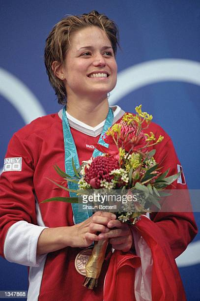 Bronze medalist Anne Montminy of Canada smiles on the podium after the Women's 10m Platform Final during the Sydney 2000 Olympic Games on September...