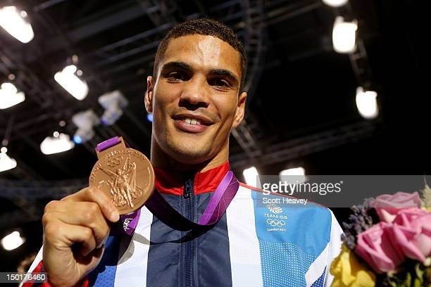 Bronze medalist Anthony Ogogo of Great Britain celebrates after the medal ceremony for the Men's Middle Boxing final bout on Day 15 of the London...