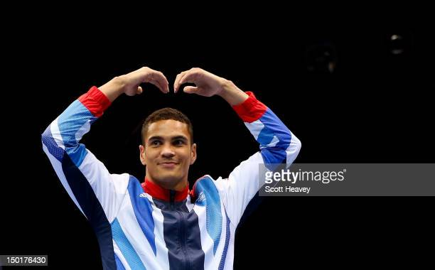 Bronze medalist Anthony Ogogo of Great Britain celebrates on the podium during the medal ceremony for the Men's Middle Boxing final bout on Day 15 of...