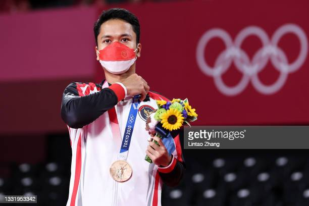 Bronze medalist Anthony Sinisuka Ginting of Team Indonesia poses on the podium during the medal ceremony for the Men's Singles badminton event on day...
