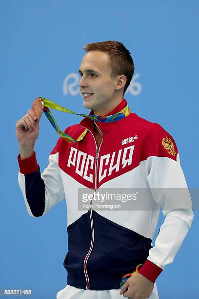 Bronze medalist Anton Chupkov of Russia poses on the podium during the medal ceremony for the Men's 200m Breaststroke Final on Day 5 of the Rio 2016...