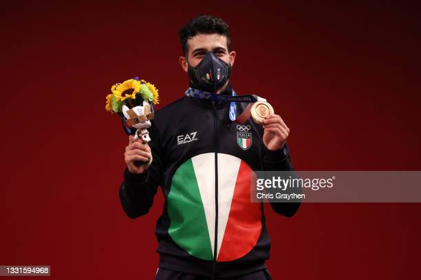 Bronze medalist Antonino Pizzolato of Team Italy poses with the bronze medal during the medal ceremony for the Weightlifting - Men's 81kg Group A on...