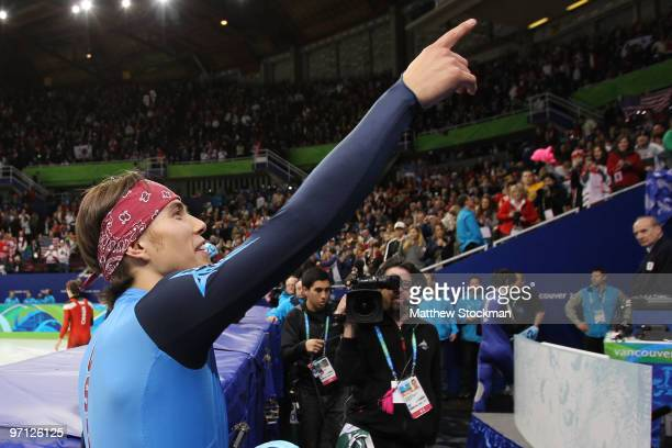 Bronze medalist Apolo Anton Ohno of the United States celebrates winning his eighth Olympic medal after the Men's 5000m Relay Short Track Speed...