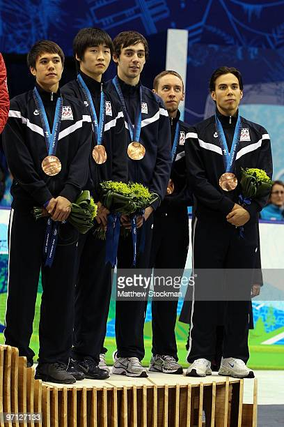 Bronze medalist Apolo Anton Ohno of the United States stands with team mates JR Celski Simon Cho Travis Jayner and Jordan Malone after the Men's...