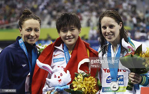Bronze medalist Ariana Kukors of the United States gold medalist Shiwen Ye of China and silver medalist Alicia Coutts of Australia pose for a photo...