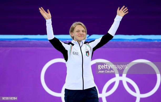 Bronze medalist Arianna Fontana of Italy celebrates during ceremony following the Short Track Speed Skating Women's 1000m Final A on day thirteen of...
