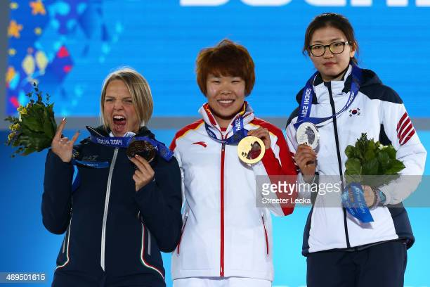 Bronze medalist Arianna Fontana of Italy gold medalist Yang Zhou of China and Silver medalist Suk Hee Shim of South Korea celebrate during the medal...