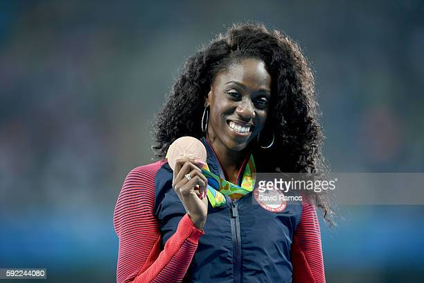 Bronze medalist Ashley Spencer of the United States poses on the podium during the medal ceremony for the Women's 400m Hurdles on Day 14 of the Rio...
