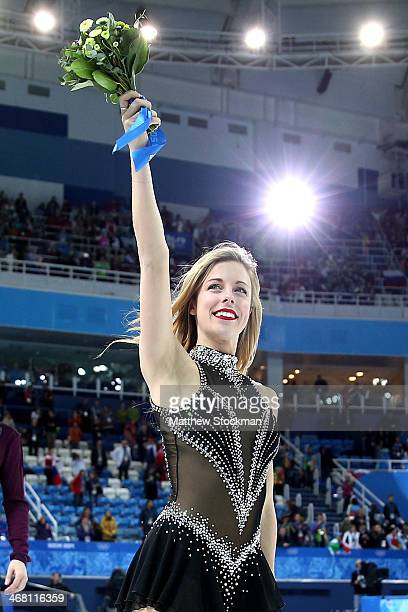 Bronze medalist Ashley Wagner of the United States celebrates after the flower ceremony for the Team Figure Skating Overall during day two of the...
