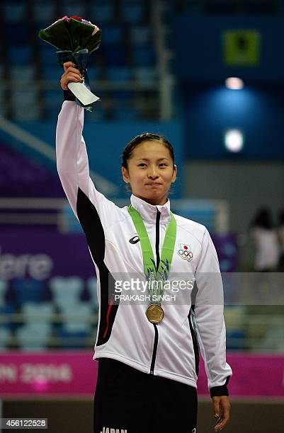 Bronze medalist Ayano Kishi of Japan poses during the medal ceremony for the women's gymnastics trampoline final at the Namdong Gymnasium during the...