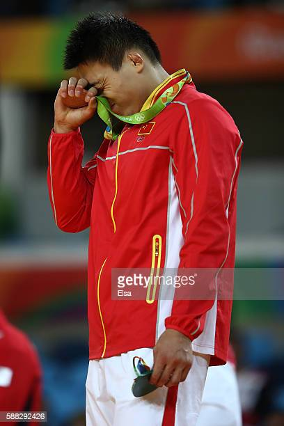 Bronze medalist B Xunzhao Cheng of China stands on the podium during the medal ceremony for the Men's 90kg Judo on Day 5 of the Rio 2016 Olympic...