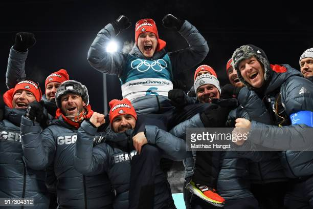 Bronze medalist Benedikt Doll of Germany celebrates with his team after the Men's Biathlon 125km Pursuit on day three of the PyeongChang 2018 Winter...