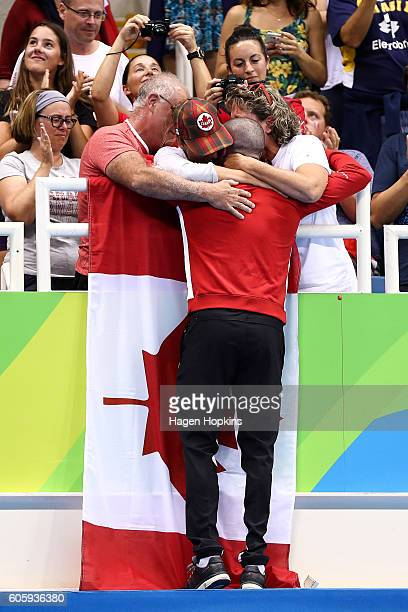 Bronze medalist Benoit Huot of Canada celebrates with family and friends at the medal ceremony for the Men's 400m Freestyle S10 Final during Day 8 of...