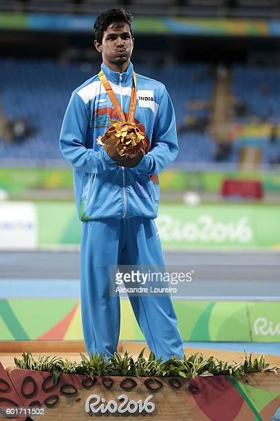 Bronze medalist Bhati Varun Singh of India celebrate on the podium at the medal ceremony for the Men's High Jump F42 Final during day 2 of the Rio...