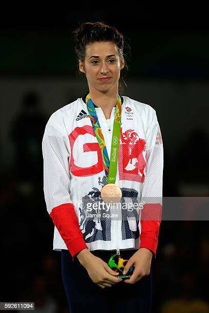Bronze Medalist Bianca Walkden of Great Britain celebrates on the podium during the medal ceremony for the Taekwondo Women 67kg Gold Medal Contest on...
