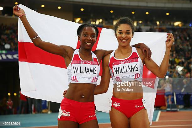 Bronze medalist Bianca Williams of England and silver medalist Jodie Williams of England celebrate after the Women's 200m Final at Hampden Park...