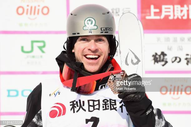 Bronze medalist Bradley Wilson of USA poses during the medal ceremony on day one of the Men's FIS Freestyle Skiing World Cup Tazawako on February 23...