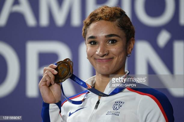 Bronze medalist Britain's Jodie Williams celebrates during the medal ceremony for the women's 400m at the 2021 European Athletics Indoor...