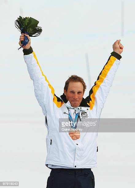 Bronze medalist Cameron RahlesRahbula of Australia celebrates at the medal ceremony for the Men's Standing Super Combined during Day 9 of the 2010...