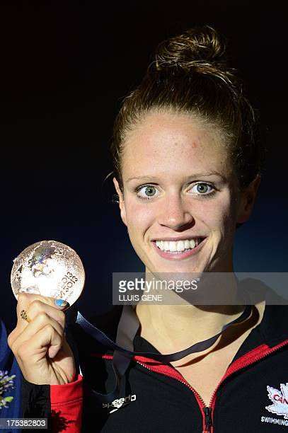 Bronze medalist Canada's Hilary Caldwell poses with her medal on the podium during the award ceremony of the final of the women's 200metre backstroke...