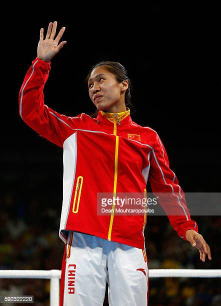 Bronze medalist Cancan Ren of China poses during the medal ceremony for the Women's Fly on Day 15 of the Rio 2016 Olympic Games at Riocentro Pavilion...