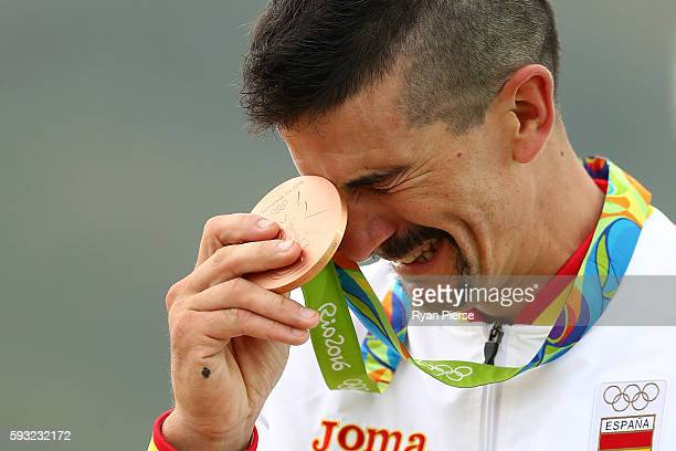 Bronze medalist Carlos Coloma Nicolas of Spain poses on the podium during the medal ceremony for the Men's CrossCountry on Day 16 of the Rio 2016...