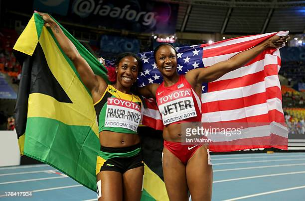 Bronze medalist Carmelita Jeter of the United States and gold medalist ShellyAnn FraserPryce of Jamaica pose after the Women's 100 metres final...