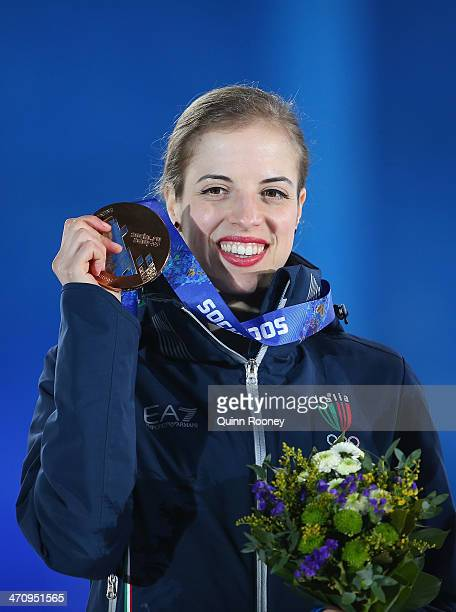 Bronze medalist Carolina Kostner of Italy celebrates during the medal ceremony for the Women's Free Figure Skating on day fourteen of the Sochi 2014...