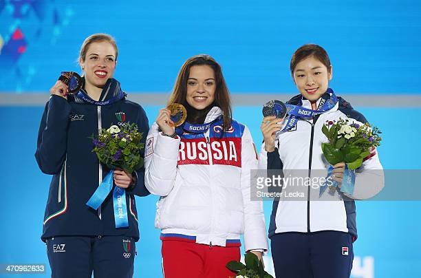 Bronze medalist Carolina Kostner of Italy Gold medalist Adelina Sotnikova of Russia and Silver medalist Yuna Kim of South Korea celebrate during the...