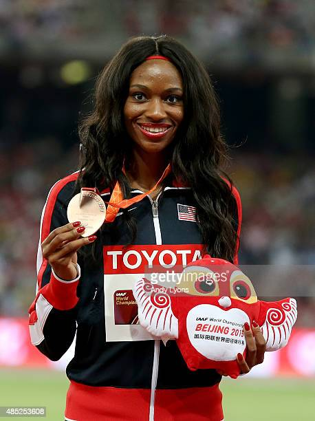 Bronze medalist Cassandra Tate of the United States poses on the podium during the medal ceremony for the Women's 400 metres hurdles final during day...