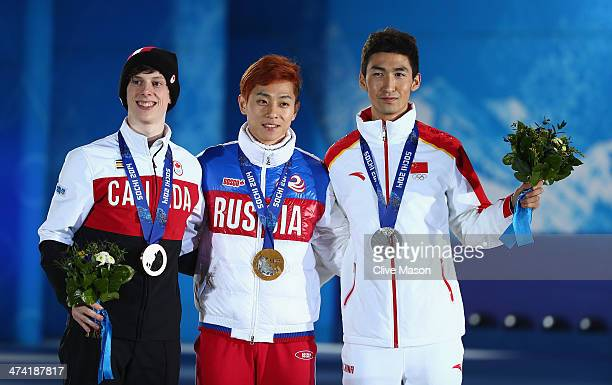 Bronze medalist Charle Cournoyer of Canada celebrate gold medalist Victor An of Russia and silver medalist Dajing Wu of China celebrate on the podium...