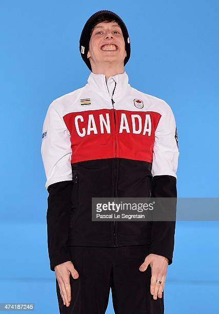 Bronze medalist Charle Cournoyer of Canada celebrates on the podium during the medal ceremony for the Short Track Men's 500m on Day 15 of the Sochi...