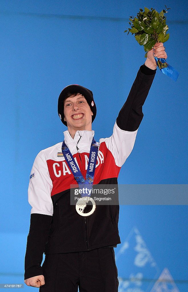 Bronze medalist Charle Cournoyer of Canada celebrates on the podium during the medal ceremony for the Short Track Men's 500m on Day 15 of the Sochi 2014 Winter Olympics at Medals Plaza on February 22, 2014 in Sochi, Russia.