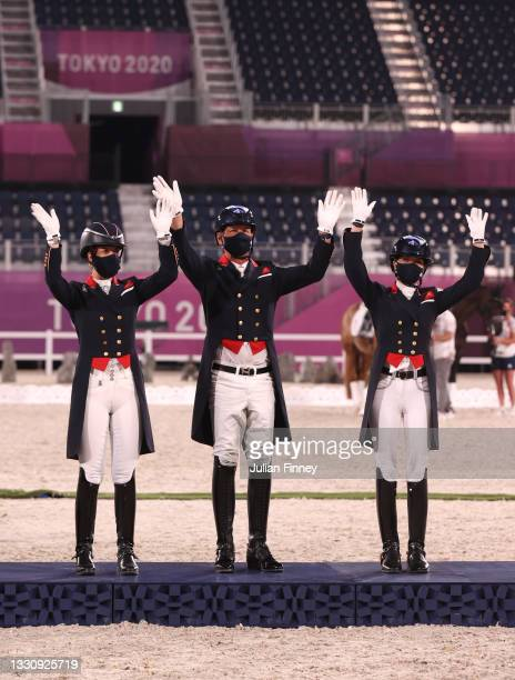 Bronze medalist Charlotte Dujardin, Carl Hester and Charlotte Fry of Team Great Britain pose on the podium during the medal ceremony for the Dressage...