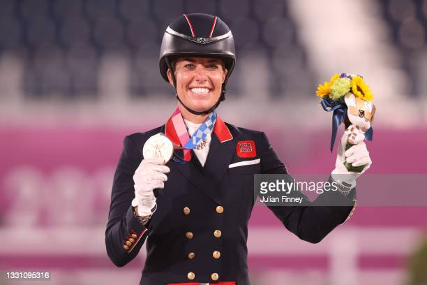 Bronze medalist Charlotte Dujardin of Team Great Britain poses on the podium during the medal ceremony for the Dressage Individual Grand Prix...