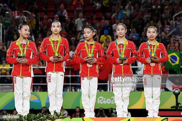 Bronze medalist China members stand on the podium at the medal ceremony for the Artistic Gymnastics Women's Team on Day 4 of the Rio 2016 Olympic...