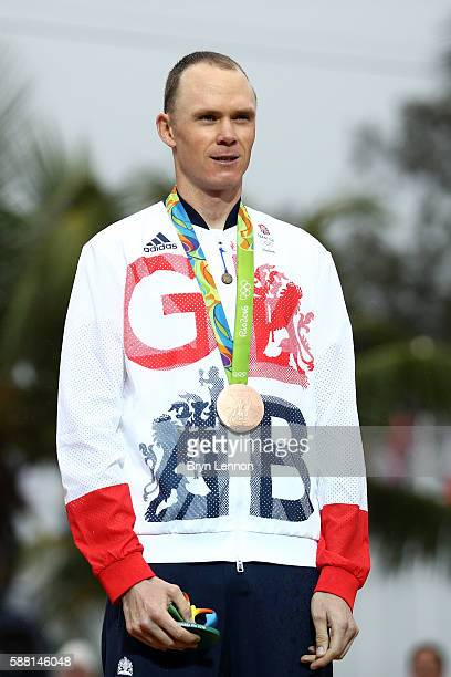 Bronze medalist Christopher Froome of Great Britain stands on the podium at the medal ceremony for the Cycling Road Men's Individual Time Trial on...