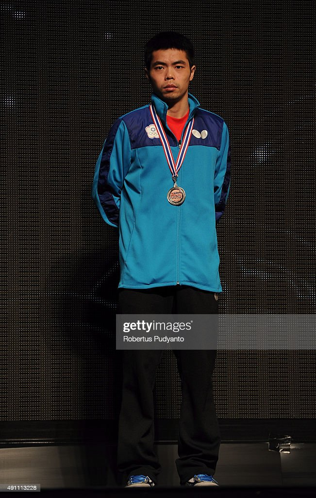 Bronze medalist Chuang Chih-Yuan of Taipei celebrates on the podium during Men's singles awarding ceremony of the 22nd 2015 ITTF Asian Table Tennis Championships at Pattaya Sports Indoor Stadium on October 3, 2015 in Pattaya, Thailand.