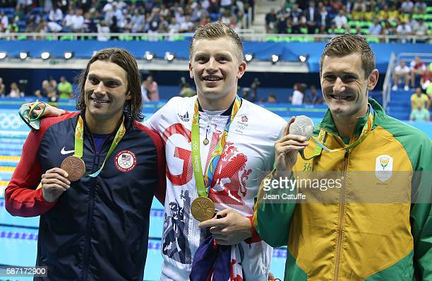 Bronze medalist Cody Miller of USA gold medalist Adam Peaty of Great Britain and silver medalist Cameron van der Burgh of South Africa pose during...