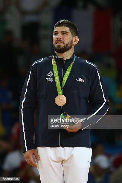 Bronze medalist Cyrille Maret of France celebrates on the podium during the men's 100kg bronze medal judo contest against KarlRichard Frey of Germany...