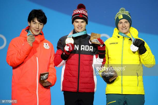 Bronze medalist Daichi Hara of Japan gold medalist Mikael Kingsbury of Canada and silver medalist Matt Graham of Australia pose during the medal...