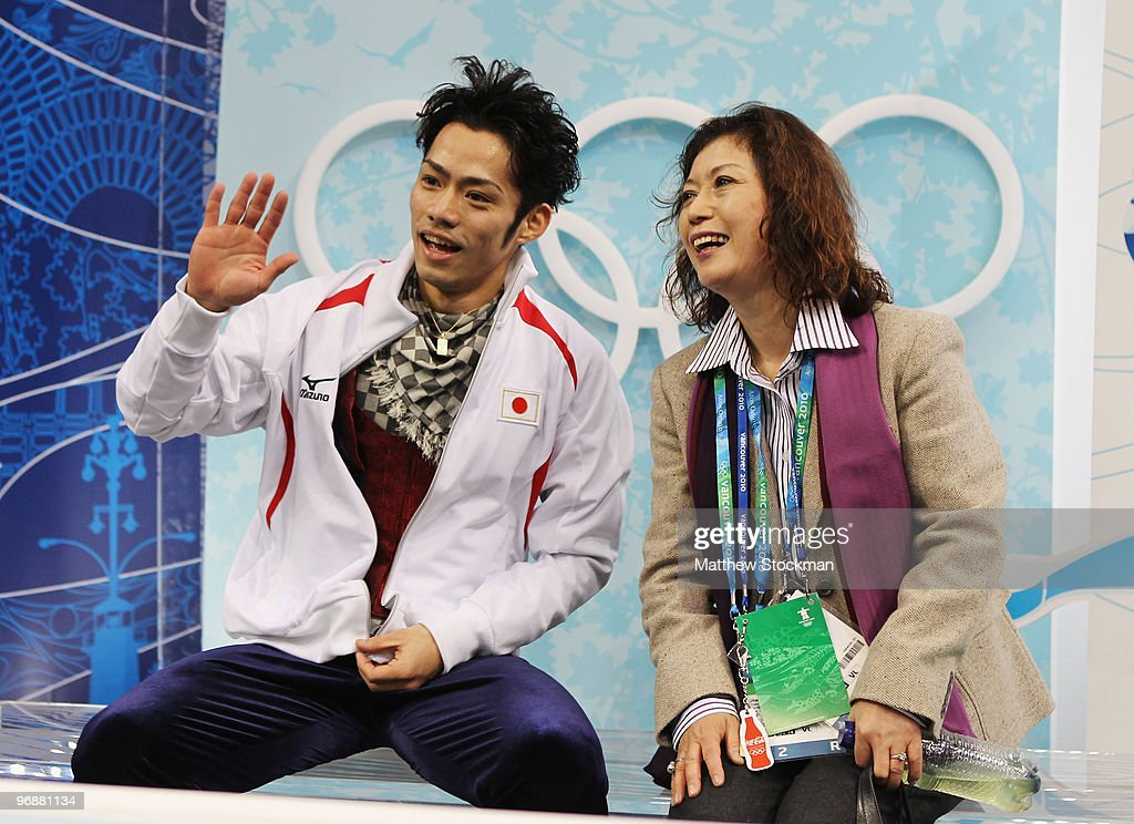 Bronze medalist Daisuke Takahashi of Japan is seen in the kiss and cry area with his coach Utako Nagamitsu during the men's figure skating free skating on day 7 of the Vancouver 2010 Winter Olympics at the Pacific Coliseum on February 18, 2010 in Vancouver, Canada.