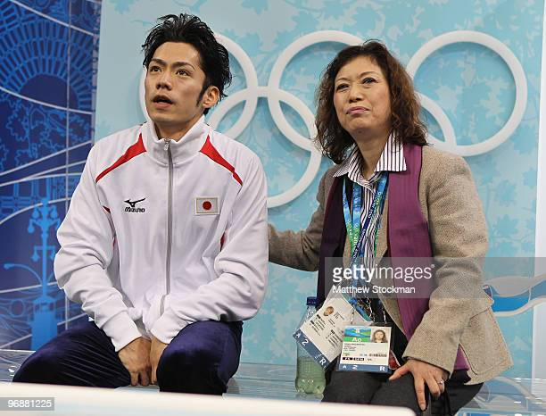Bronze medalist Daisuke Takahashi of Japan is seen in the kiss and cry area with his coach Utako Nagamitsu during the men's figure skating free...