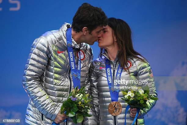 Bronze medalist Danelle Umstead and guide Robert Umstead kiss as they celebrate at the medal ceremony for women's Super Combined Visually Impaired on...