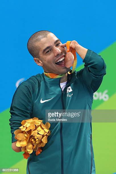 Bronze medalist Daniel Dias of Brazil celebrates on the podium at the medal ceremony for the Men's 50m Butterfly S5 Final on day 3 of the Rio 2016...